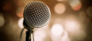 Image close-up of microphone on abstract background