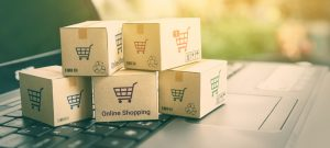 Ecommerce header image of shipping boxes on a laptop keyboard